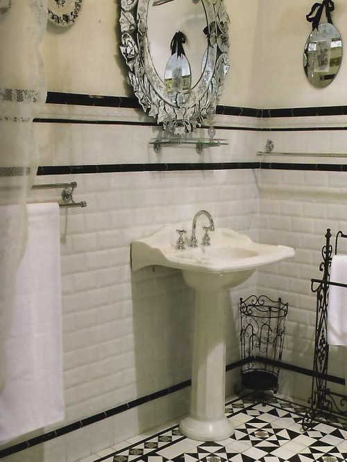 A five foot wainscot using white subway tile with black accents. The Victorian Bath  The Comfortable Bathroom   Homeowner Guide