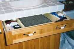 Wrap-around sink drawer conveniently stores scads of small jars and other items..